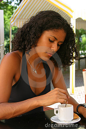 Beautiful brazilian woman having a coffee