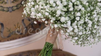 Bridal bouquet on a vintage chair. Beautiful bridal bouquet for a wedding lying on a vintage chair close-up stock footage