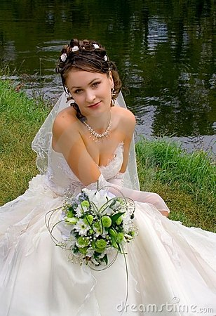Brunette bride by the water
