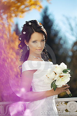 Beautiful bride in the autumn park