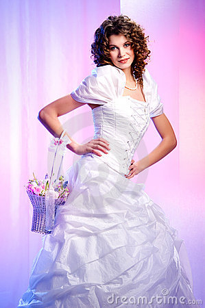 Beautiful bride with a basket of spring flowers