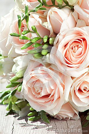 Wedding bouquet of white freesias and pink roses
