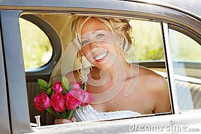 Beautiful Bride in Car on wedding day