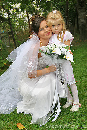 Beautiful bride and child