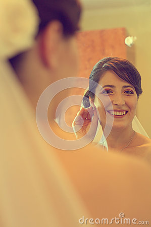 Beautiful bride getting ready for wedding