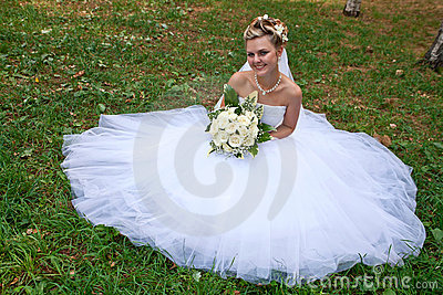 Beautiful bride on grass
