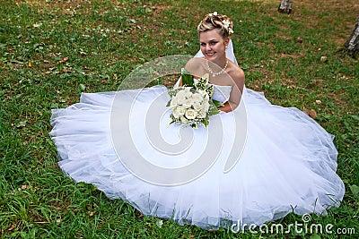 Beautiful bride on grass
