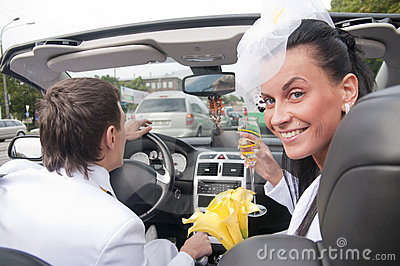 Beautiful bride and groom in cabrio