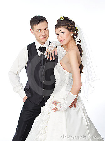 Beautiful bride and groom over white