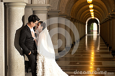 A beautiful bride and handsome groom at Christian church during wedding.