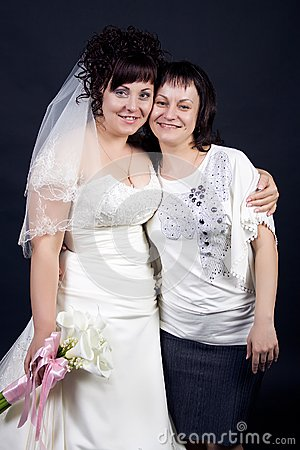 Beautiful bride with her sister on a black backgro