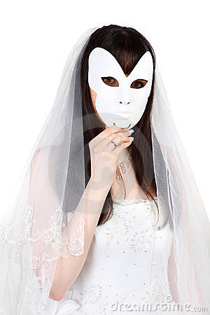 Beautiful bride hid face behind mask