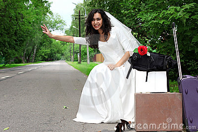 Beautiful bride hitch-hike