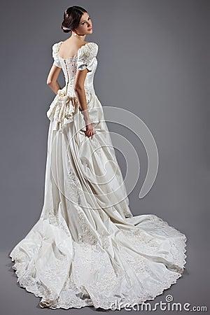 Free Beautiful Bride In Satin Long Dress Royalty Free Stock Image - 119349356