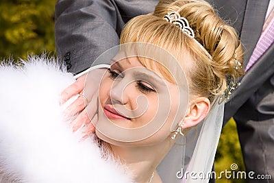 Beautiful bride is looking wedding ring