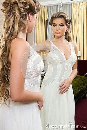 Beautiful bride at the mirror