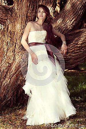 Beautiful bride posing at nature