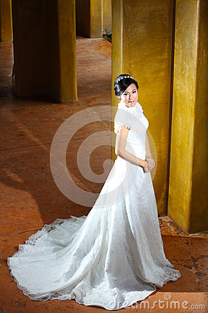 Beautiful bride posing near pillars