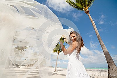 Beautiful bride posing at a tropical beach