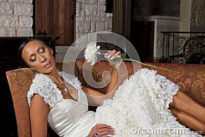 Beautiful Bride Reclining In Wedding Gown