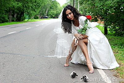 Beautiful bride at the road