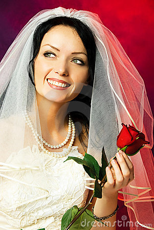 Beautiful bride with a rose