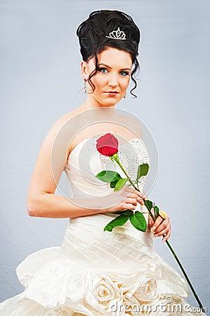 Beautiful bride with rose in studio