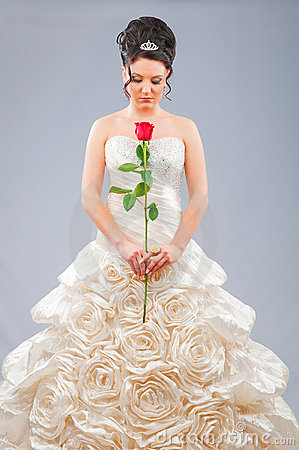 Beautiful bride with rose in studio