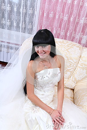 Beautiful bride sitting in chair