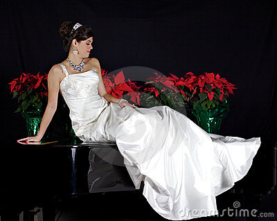 Beautiful Bride Sitting on a Piano