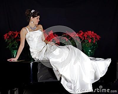 Beautiful Bride Sitting on a Piano