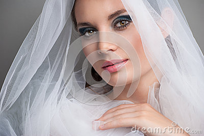 Beautiful bride with veil over her face