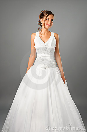 Beautiful bride wearing wedding dress in studio