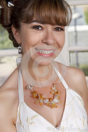 Beautiful Bride In Wedding Gown Wearing A Necklace