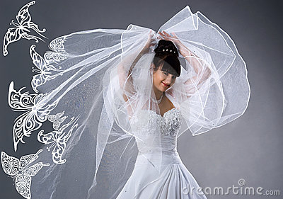 Beautiful bride in a white dress with butterflies