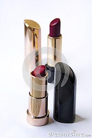 Beautiful bright lipstick in a gold box Stock Photo
