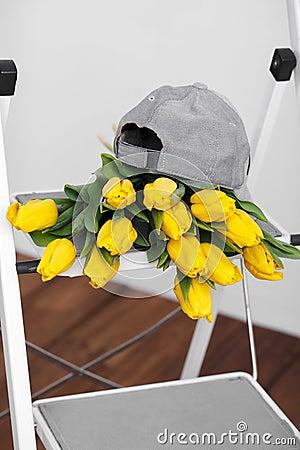 Beautiful bright yellow tulips More lying on sofa white stairs