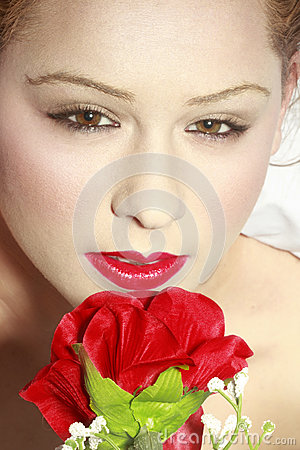 Beautiful brown eyed girl with rose