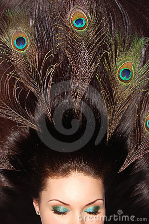 Beautiful brunet long hair decorated with peacock