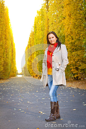 Beautiful brunette in the autumnal park