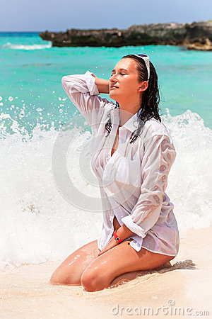 Beautiful brunette on the beach of Caribbean Sea