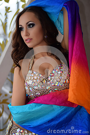 Free Beautiful Brunette, Belly Dancer With Rainbow Shawl In The Arabic Harem Interior Royalty Free Stock Image - 79335486