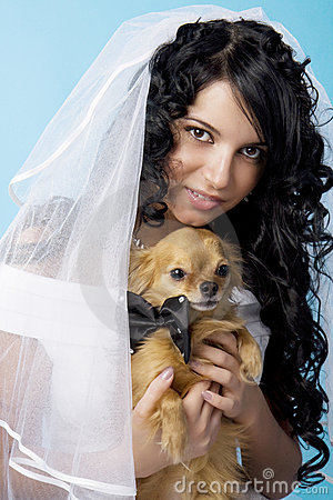 Beautiful brunette bride with a dog
