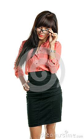 Beautiful brunette business woman looking at the camera