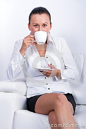 Beautiful brunette at coffee break