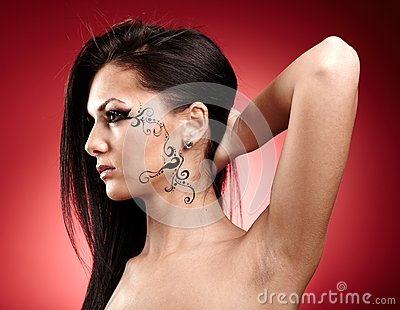 Beautiful brunette with facial tattoo