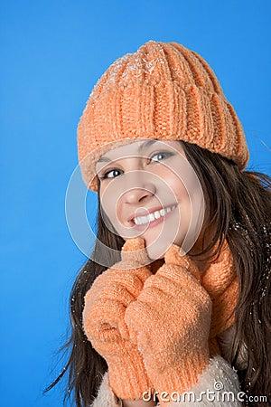 Beautiful brunette girl in the orange cap