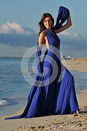 Beautiful brunette girl posing at the ocean shoreline