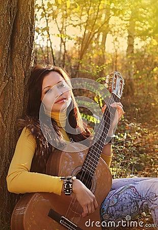 Beautiful brunette guitar player girl