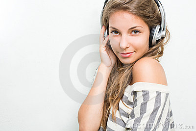 Beautiful  brunette immersed in music, smiling